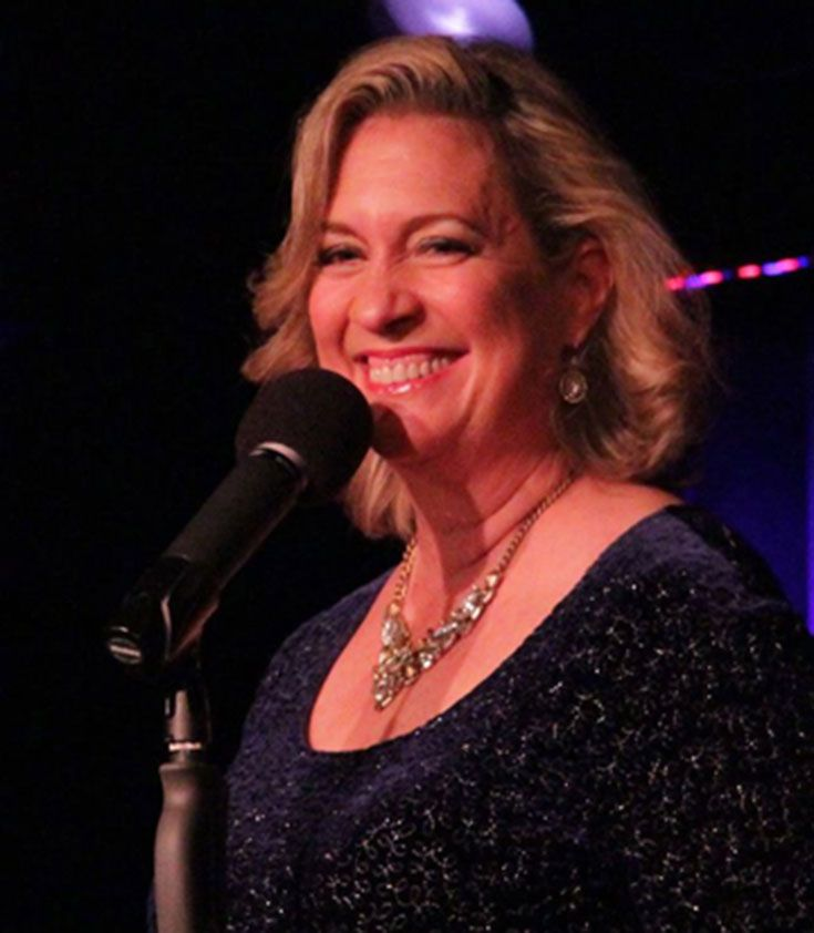 "Carolyn Montgomery-Forant '82 performing in her show ""Visible Phoenix"" at the Laurie Beechman Theatre."