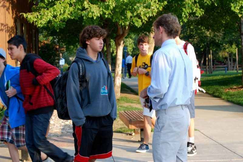 "US Faculty greet students during drop off each morning and know them well enough to ask, ""How was your game/performance last night?"""